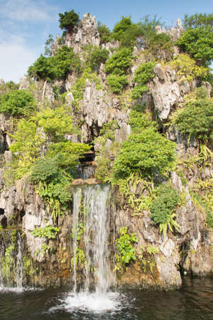 Chinese garden with waterfall photo