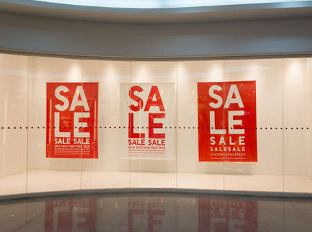 Sale sign text on wall in marketplace photo