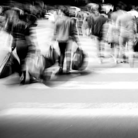 Commuters crossing at rush hour, blur motion photo