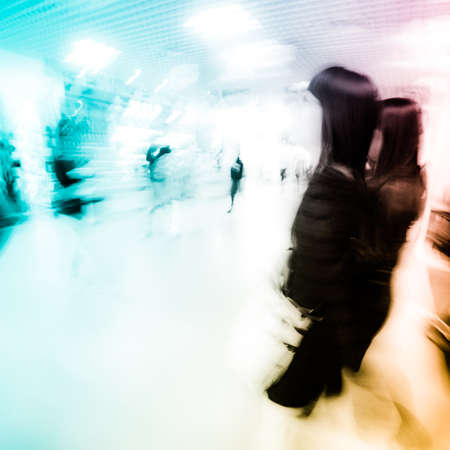 fashion women in shopping center abstract blur photo