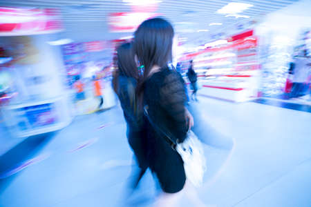 fashion women in shopping center abstract blur Stock Photo - 18284114