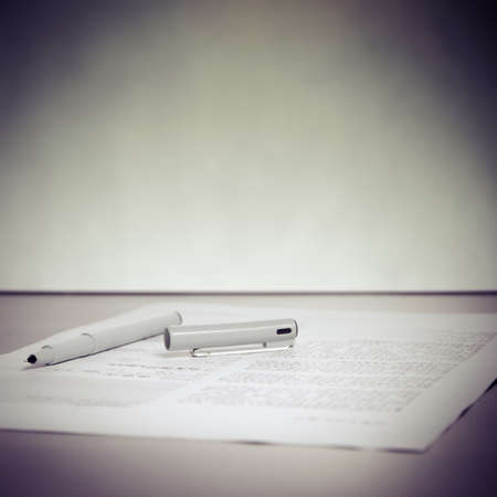 business pen and paper on desk Stock Photo - 19344866