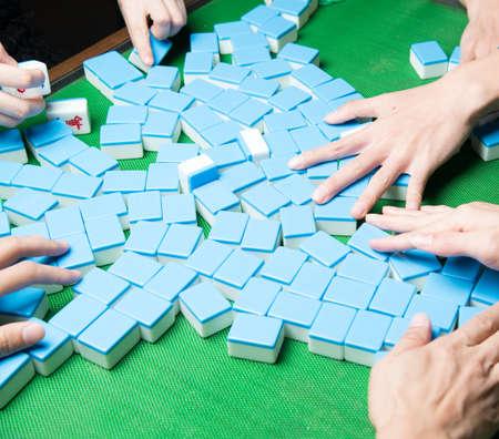 mahjong: people palying mahjong game Stock Photo