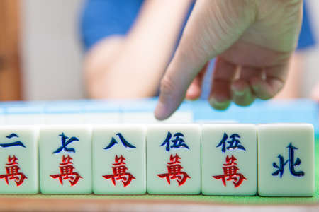 people palying mahjong game