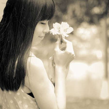 Asian beauty teenage girl portrait with flower in hand photo