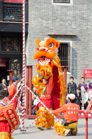 Foshan,China- Feb. 19: Chinese Lion dance perform on Feb. 19, 2012 in Foshan, China. lion dance can be often seen in festive celebrations.