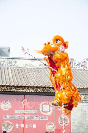often: Foshan,China- Feb. 19: Chinese Lion dance perform on Feb. 19, 2012 in Foshan, China. lion dance can be often seen in festive celebrations. Editorial