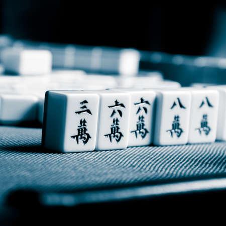 mahjong: people playing mahjong game