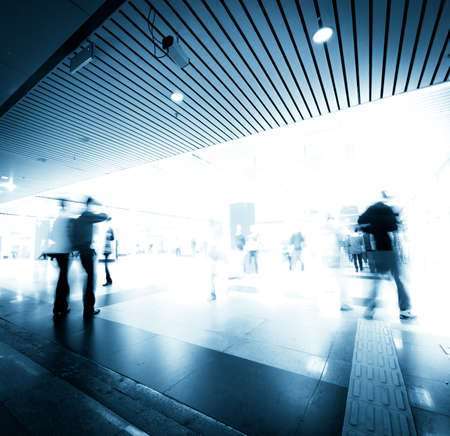 abstract business people rush on urban shopping center blur motion photo