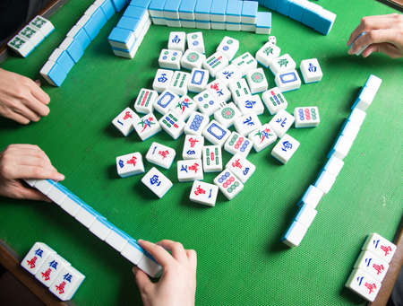 people playing mahjong game photo