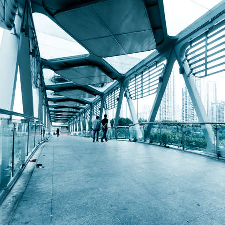 people walking on modern urban city platform bridge,blur motion. photo