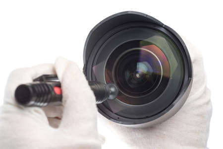 cleaning camera lens with a lens pen photo
