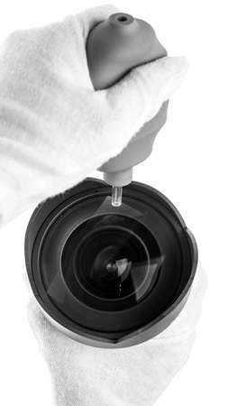 cleaning camera lens with a air blowing photo