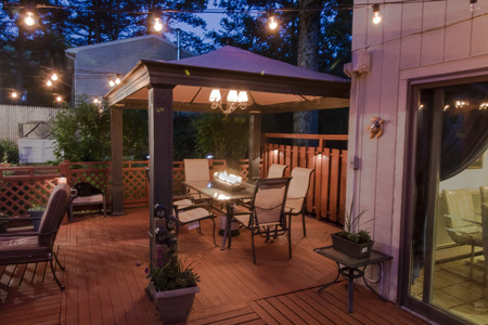 This is the dining area of a grand deck built by the owner of the home.  Great place to dine and entertain.