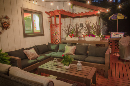 A deck built by the owner of the home.  Equipped with a kitchen (with running water), dining area and a living room,   this deck is great for parties and social events.