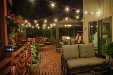 A beautiful backyard deck.  Complete with Kitchen, dining area and living room.  I waited until the party was over before I snapped some shots.