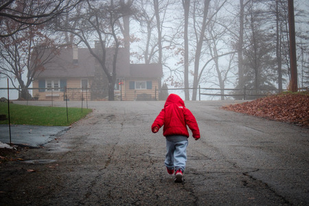 A 3 year old as he takes to the neighborhood for a day of fun and adventure.  Photo was taken on a cool December morning in New Jersey.