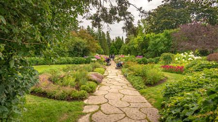 Metis-sur-Mer, Quebec, Canada - August 23, 2018: Mixed border of perennial and annual plants captured during an overcast summer day in Reford garden, Metis-sur-mer, Quebec Editorial