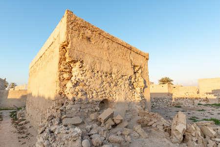 Ruined house still standing in the abandoned village of Al Jazirah Al Hamra at sunset, Emirate of Ras Al Khaimah, United Arab Emirates