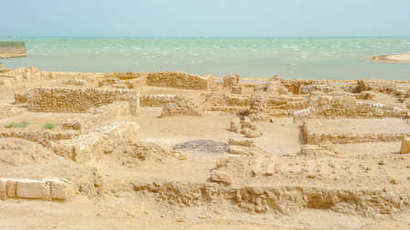 Archaeological excavations of an old fort and the Arabian gulf in the background, Qal'at al-Bahrain