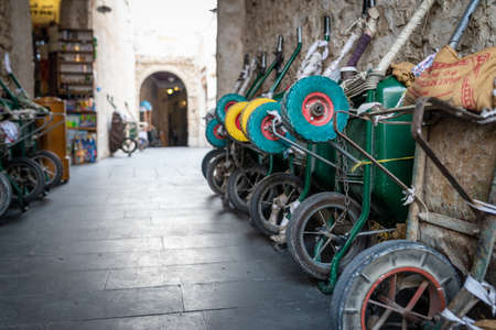 Doha, Qatar - 25 Nov 2016: Row of wheelbarrows waiting for their porter in the early afternoon. Taken in Souq Wakif, Doha