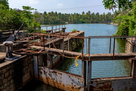 Lock between fresh and brackish water. Taken on a sunny spring afternoon with no people, Kerala, India 스톡 콘텐츠