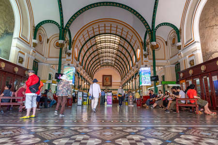 Ho Chi Minh City, Vietnam - April 9, 2018: Interior of the main post office of Ho Chi Minh City, built during the french period, with some passersby and clients, mostly locals