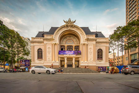 Ho Chi Minh City, Vietnam - April 8, 2018: Ho Chi Minh City Opera House facade, built during the french period, taken at the end of the day, with some cars and passersby.