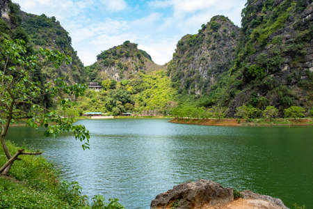 Tuyet Tình Coc park and Chua Am Tien temple, taken on a partly overcast day, Ninh Binh Province, Vietnam 写真素材