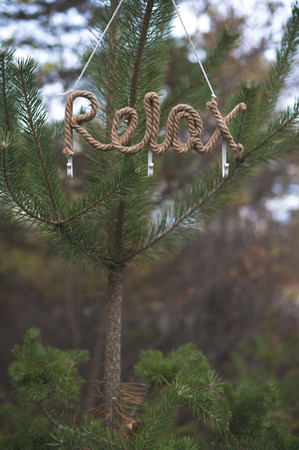 Word relax on tree in the forest Stock Photo