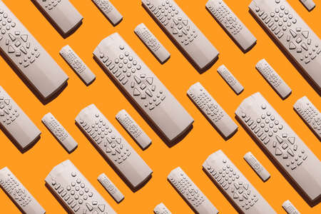 TV remote pattern of many devices Stock Photo