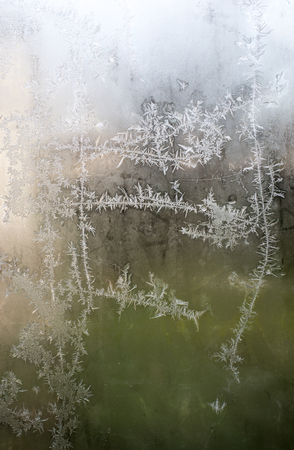 Frost on the window. Green background