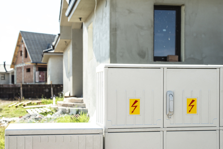 Electric switchboard in front of new build house