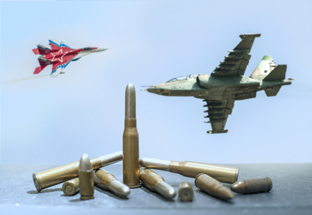 Military supersonic fighters in battle on the sky. Cartridges and ammunition in the foreground.