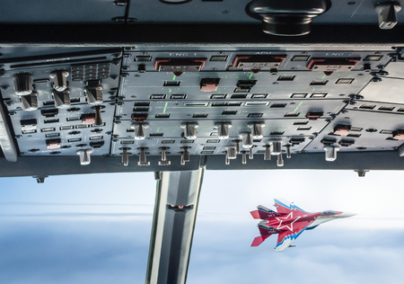 Military supersonic fighters in battle on the sky. Stock Photo