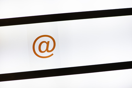 Email symbol at on backlight. Internet communication concept.