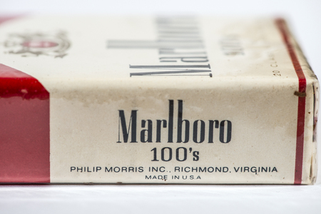 Vintage Marlboro cigarettes 100s produced in the USA. Banderole on top of the pack.  Red package. Close shot of filter cigarettes pack. US tax exempt for use outside USA. Philip morris producer.