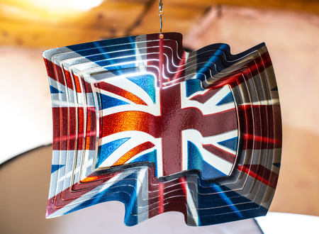 English flag on plate. Shiny metallic plate with the United Kingdom flag on it. UK concept.