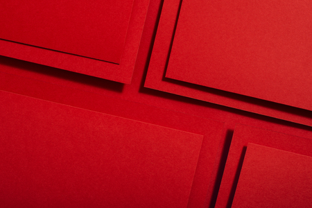 Red paper material design. Geometric unicolour shapes. Wallpaper design background.