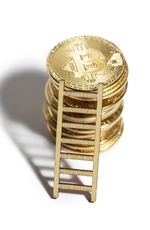 Many bitcoin coins stacked and leaned ladder. White isolated bitcoins. Concept for cryptocurrencies and investments.