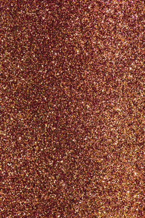 Shiny sparkle red and yellow background texture. Luxury, party and holidays concept.