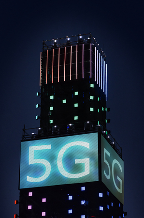 5G wireless conceptual text on illuminated adver at night. Concept for high speed 5G internet. 版權商用圖片