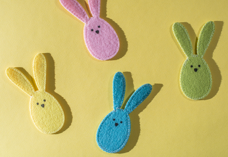 Easter bunnies on bright yellow background. Stock Photo