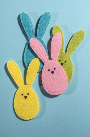 Easter bunnies on bright blue background.