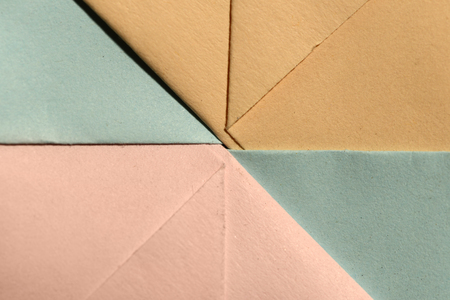 Abstract geometric paper shapes. Pastel tones crumpled paper. Hard light.