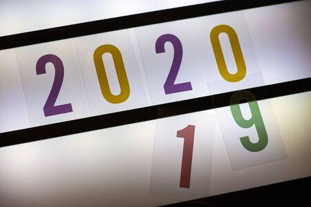 Year 2020 symbol on illuminated board. Back light Imagens