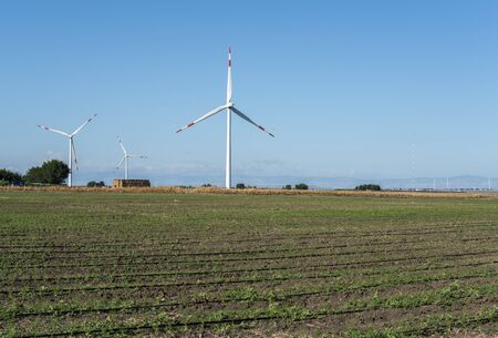 Wind generator and agricultural land. Renewable energy concept