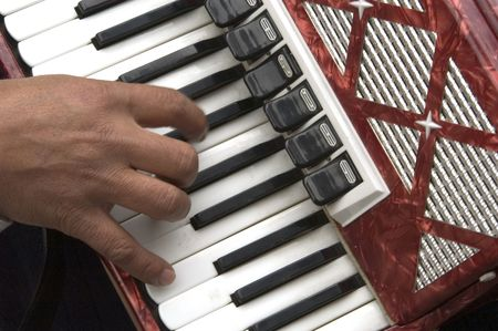 virtuoso: hand play the accordion in the streets of brugge