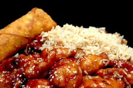 Chinese Food, Sesame Chicken, Isolated on Black Zdjęcie Seryjne