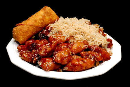 black dish: Chinese Food, Sesame Chicken, Isolated on Black Stock Photo